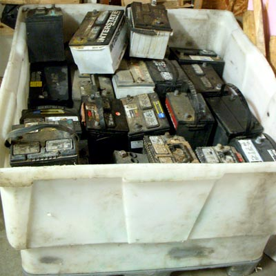 Bin of old automotive batteries getting ready to be recycled