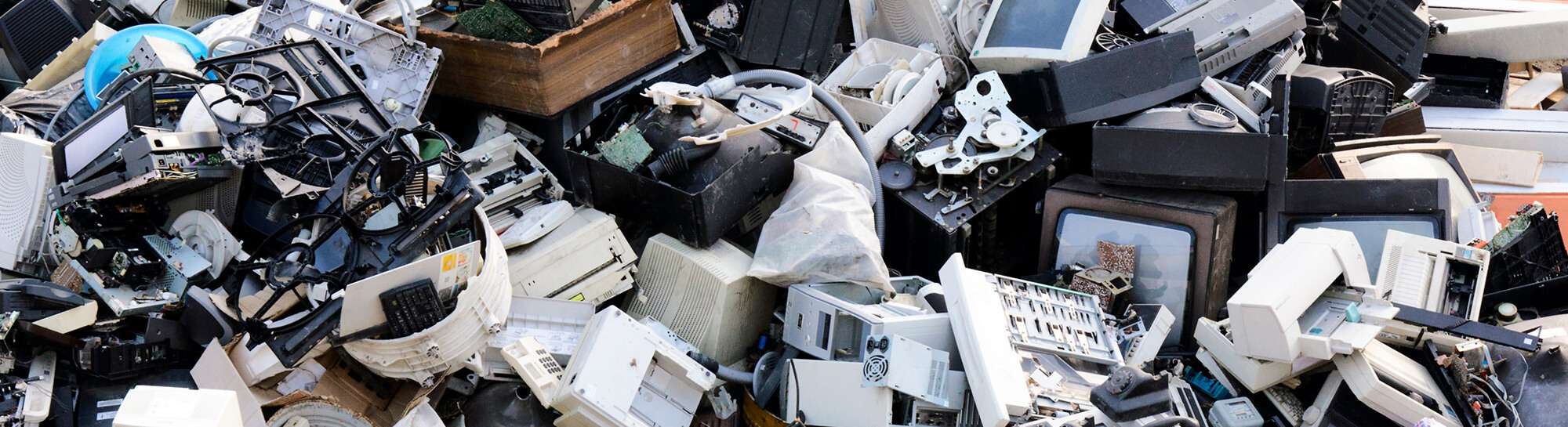 Pile of obsolete computers, scanners, and electronic devices